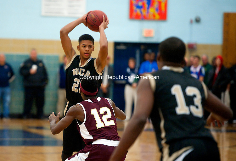 WATERBURY, CT--- -121915JS11--Career Academy's Marquan Watson (22) looks to pass while being guarded by Sacred Heart's Charles Fisher (12) during the annual boys basketball jamboree held Saturday at Kennedy High School in Waterbury, <br /> Jim Shannon Republican-American
