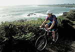 Bicyclist with Mendocino Bay in the background