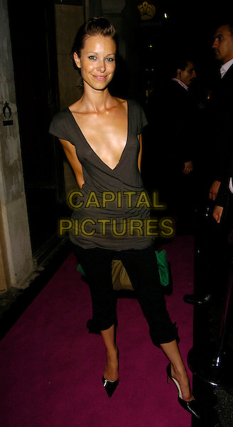 ABBIE EASTWOOD.The Pout Cosmetic Range 5th Birthday Party, Cuckoo Club, London, UK..July 18th, 2006.Ref: CAN.full length black cropped trousers plunging neckline brown top.www.capitalpictures.com.sales@capitalpictures.com.©Can Nguyen/Capital Pictures