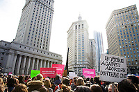 Thousands of New Yorkers participate in the Rally to Protect Women's Health in Foley Square, across from the Court House in Lower Manhattan, New York, in response to the passage of the Pence Amendment on 26 February 2011.  The Amendment would eliminate basic health care and education services for millions of Americans if made into law.