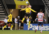COLUMBUS, OHIO - SEPTEMBER 11, 2012:  Geoff Cameron (21) of the USA heads away from Ryan Johnson (9) MNT of  Jamaica during a CONCACAF 2014 World Cup qualifying  match at Crew Stadium, in Columbus, Ohio on September 11. USA won 1-0.