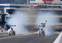 Sep 15, 2013; Charlotte, NC, USA; NHRA top fuel dragster driver Spencer Massey (left) defeats Brittany Force during the Carolina Nationals at zMax Dragway. Mandatory Credit: Mark J. Rebilas-