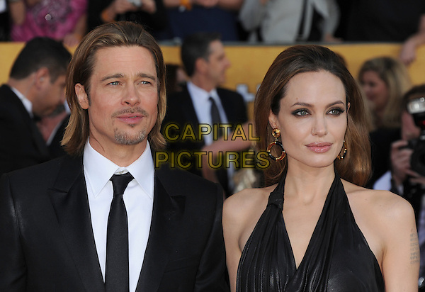 Brad Pitt, Angelina Jolie.Arrivals to the 18th Annual Screen Actors Guild Awards held at The Shrine Auditorium, Los Angeles, California, USA..January 29th, 2012.SAG SAGS headshot portrait black satin halterneck cowl neck suit couple goatee facial hair tattoo gold earrings hoop.CAP/ROT/TM.©Tony Michaels/Roth Stock/Capital Pictures
