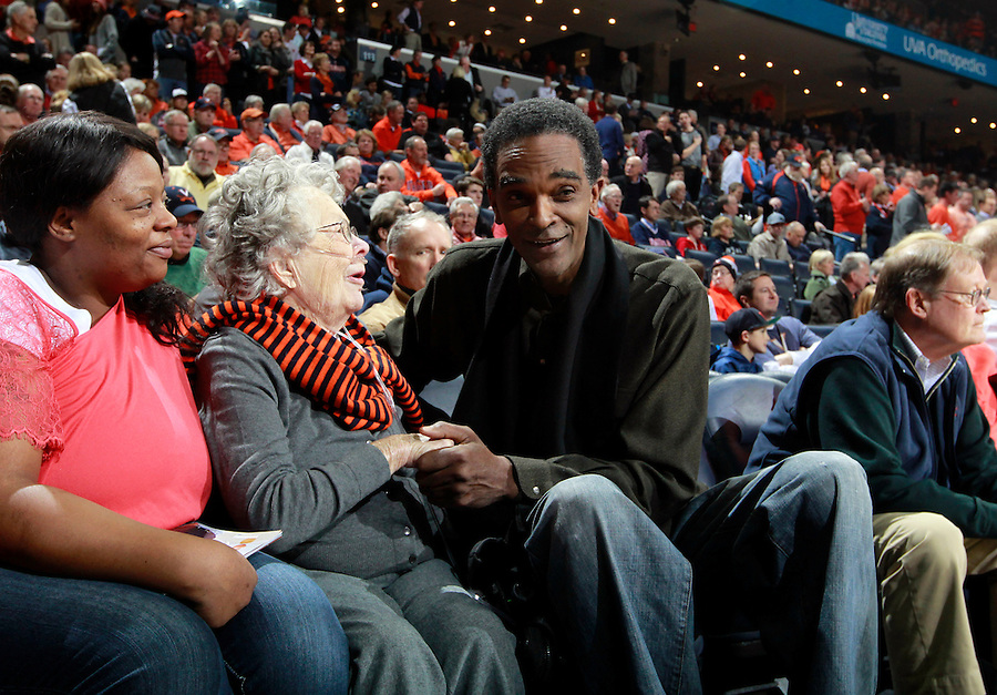 Former Virginia star Ralph Sampson greets Bessie Birckhead, an 89-year-old Charlottesville resident, during an ACC basketball game against Clemson Jan. 13, 2015 in Charlottesville, VA Virginia won 65-42.