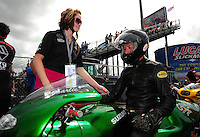 Mar. 9, 2012; Gainesville, FL, USA; NHRA pro stock motorcycle rider Charlie Sullivan (right) with daughter Katie Sullivan during qualifying for the Gatornationals at Auto Plus Raceway at Gainesville. Mandatory Credit: Mark J. Rebilas-