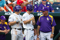 Louisiana State head coach Paul Mainieri talks with Alex Bregman (30) and Mason Katz (8) during Game 7 of the 2013 Men's College World Series against the North Carolina Tar Heels on June 18, 2013 at TD Ameritrade Park in Omaha, Nebraska. The Tar Heels defeated the Tigers 4-2, eliminating LSU from the tournament. (Andrew Woolley/Four Seam Images)