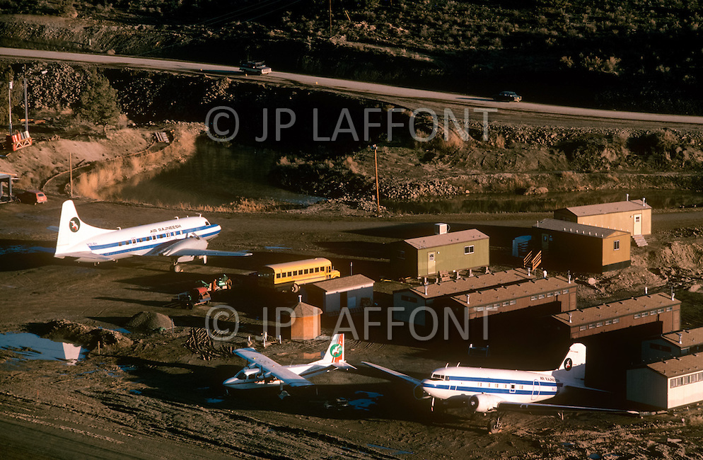 Wasco, Oregon, January 1984: Rajneeshpuram airport, a community-owned company owned 3 DC-3 planes.   Rajneeshpuram, was an intentional community in Wasco County, Oregon, briefly incorporated as a city in the 1980s, which was populated with followers of the spiritual teacher Osho, then known as Bhagwan Shree Rajneesh. The community was developed by turning a ranch from an empty rural property into a city complete with typical urban infrastructure, with population of about 7000 followers.