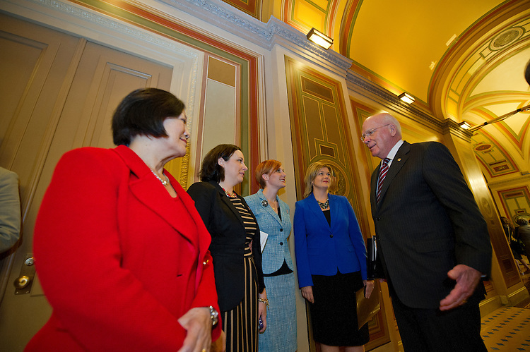 UNITED STATES - Oct 29: Senate Judiciary Committee Chairman Patrick Leahy (D-Vt.) (R) and Senator Mazie Hirono (D-Hawaii) (L) greeted military spouses in the U.S. Capitol on October 29, 2013 before a press conference to call for the confirmation of Patricia Millett to the D.C. Circuit Court of Appeals. Millett's nomination will be debated in the Senate this week.   (Photo By Douglas Graham/CQ Roll Call)