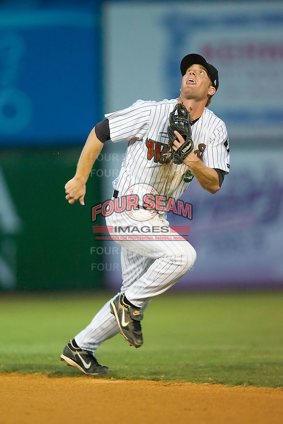 Second baseman Dale Mollenhauer (15) of the Winston-Salem Warthogs tracks down a pop up at Ernie Shore Field in Winston-Salem, NC, Thursday July 27, 2008. (Photo by Brian Westerholt / Four Seam Images)