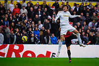 Sunday, 23 November 2012<br /> <br /> Pictured: Michu of Swansea City jumps for the ball <br /> <br /> Re: Barclays Premier League, Swansea City FC v Manchester United at the Liberty Stadium, south Wales.