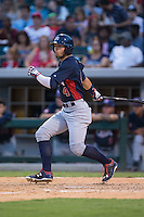Nick Banks (4) of the US Collegiate National Team follows through on his swing against the Cuban National Team at BB&T BallPark on July 4, 2015 in Charlotte, North Carolina.  The United State Collegiate National Team defeated the Cuban National Team 11-1.  (Brian Westerholt/Four Seam Images)