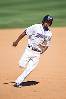 Cleuluis Rondon (5) of the Winston-Salem Dash hustles towards third base against the Lynchburg Hillcats at BB&T Ballpark on August 2, 2015 in Winston-Salem, North Carolina.  The Hillcats defeated the Dash 8-3.  (Brian Westerholt/Four Seam Images)
