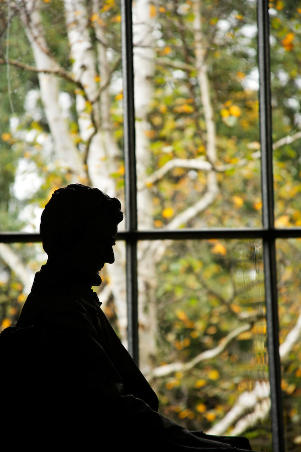 Statue of Abraham Lincoln silhouetted against window with fall foliage, Little Studio, Saint-Gaudens National Historic Site, Cornish, Sullivan County, New Hampshire, USA