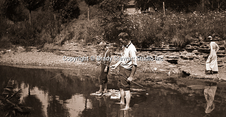 Cleveland OH:  Family fishing in stream near Lake Erie - 1915