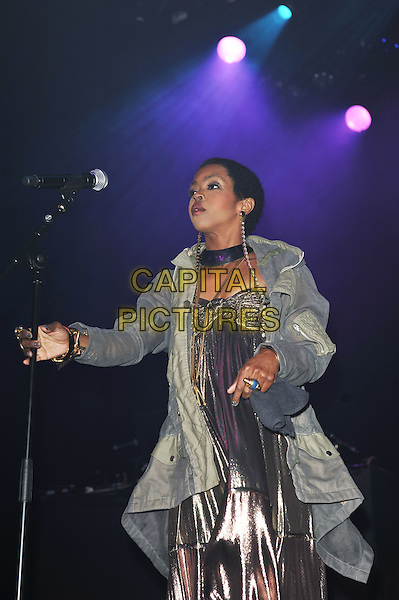 Lauryn Hill .performing live in concert at indigo2, Greenwich, London, England UK, .14th April 2012..music live on stage performing in concert gig half length silver shiny dress jacket coat grey gray anorak necklaces lame  microphone .CAP/MAR.© Martin Harris/Capital Pictures.