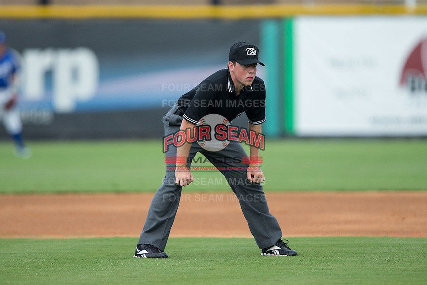 Umpire Austin Jones handles the calls on the bases during the Appalachian League game between the Danville Braves and the Burlington Royals at Burlington Athletic Park on July 12, 2015 in Burlington, North Carolina.  The Royals defeated the Braves 9-3. (Brian Westerholt/Four Seam Images)