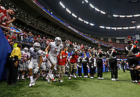 Ohio State Buckeyes take the field at the start of the Allstate Sugar Bowl college football Playoff Semifinal game between Ohio State and Alabama at the Mercedes-Benz Superdome in New Orleans, Louisiana on January 1, 2015.  (Dispatch photo by Kyle Robertson)
