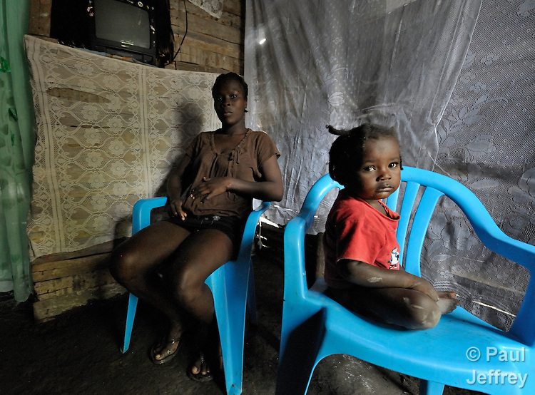A mother and daughter in their home in Batey Bombita, a community in the southwest of the Dominican Republic whose population is composed of Haitian immigrants and their descendents.