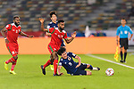Minamino Takumi of Japan (R) competes for the ball with Harib Al Saadi of Oman (2nd L) during the AFC Asian Cup UAE 2019 Group F match between Oman (OMA) and Japan (JPN) at Zayed Sports City Stadium on 13 January 2019 in Abu Dhabi, United Arab Emirates. Photo by Marcio Rodrigo Machado / Power Sport Images