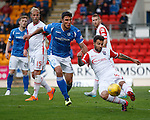 Richard Foster clears from John Sutton