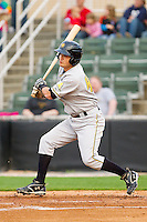 Kawika Emsley-Pai #49 of the West Virginia Power follows through on his swing against the Kannapolis Intimidators at Fieldcrest Cannon Stadium on April 21, 2011 in Kannapolis, North Carolina.   Photo by Brian Westerholt / Four Seam Images