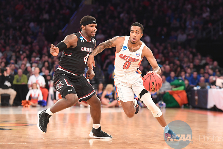 NEW YORK, NY - MARCH 26:  Kasey Hill #0 of the Florida Gators is guarded by Rakym Felder #4 of the South Carolina Gamecocks during the 2017 NCAA Men's Basketball Tournament held at Madison Square Garden on March 26, 2017 in New York City. (Photo by Justin Tafoya/NCAA Photos via Getty Images)<br /> ***Local Caption***Kasey Hill;Rakym Felder