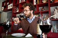 Filippo Chia, director of Castello Romitorio winery farm  during a test of a red wine at the testing room..Filippo Chia, direttore dell'Azienda vinicola Castello Romitorio durante un assaggio di un vino rosso nella testing room dell'azienza...
