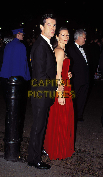 PIERCE BROSNAN  & KEELEY SHAYE SMITH.Ref: 1766 .second wife, full length, full-length.*RAW SCAN - photo will be adjusted for publication*.www.capitalpictures.com.sales@capitalpictures.com.© Capital Pictures