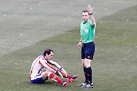 Atletico de Madrid's Diego Godin injured in presence of spanish referee Fernandez Borbalan during La Liga match.February 7,2015. (ALTERPHOTOS/Acero) /NORTEphoto.com