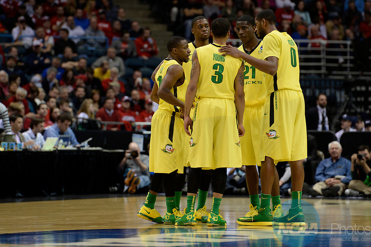 20 MAR 2014:  The University of Oregon takes on Brigham Young University during the second round of the 2014 NCAA Men's Basketball Tournament held at the BMO Harris Bradley Center in Milwaukee, WI.  Oregon defeated BYU 87-68.  Jamie Schwaberow/NCAA Photos