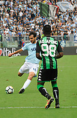 1st October 2017, Stadio Olimpico, Rome, Italy; Serie A football, Lazio versus Sassuolo; Marco Parolo shoots as he is closed down by Claud Adjapong