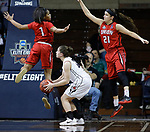 SIOUX FALLS, SD: MARCH 21:  Kelsey Williams #13 of Central Missouri gets Union defenders Jada Perkins #1 and Tiffany Rechis #21 up in the air during their game at the 2018 Division II Women's Basketball Championship at the Sanford Pentagon in Sioux Falls, S.D. (Photo by Dick Carlson/Inertia)