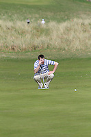 Desmond Morgan (Mullingar) on the 13th green during round 2 of The West of Ireland Amateur Open in Co. Sligo Golf Club on Saturday 19th April 2014.<br /> Picture:  Thos Caffrey / www.golffile.ie