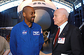 Former astronaut and United States Senator John H. Glenn Jr. (Democrat of Ohio, retired) talks with Robert L. (Bobby) Satcher Jr. of NASA's 2004 astronaut class, with the Space Shuttle Enterprise in the background during the Space Day activities at the National Air and Space Museum's Steven F. Udvar-Hazy Center in Chantilly, Virginia on May 6, 2004.Mandatory Credit: Renee Bouchard / NASA via CNP