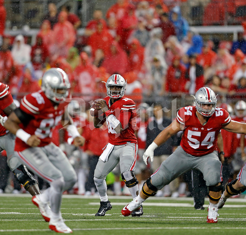 Ohio State Buckeyes quarterback J.T. Barrett (16) against Tulsa Golden Hurricane during their game at Ohio Stadium in Columbus, Ohio on September 10, 2016.  (Kyle Robertson / The Columbus Dispatch)