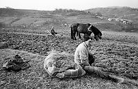 ROMANIA / Maramures / Valeni / April 2003..Ilya, 29, rests while helping a friend plow a plot of land in springtime. In Maramures, peasants grow all of their own food and farm work continues to be non-mechanized on account of the hilly terrain and relative poverty....© Davin Ellicson / Anzenberger..