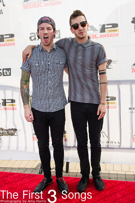 Tyler Joseph and Josh Dun of twenty | one | pilots attends the 2014 AP Music Awards at the Rock And Roll Hall Of Fame and Museum at North Coast Harbor in Cleveland, Ohio.