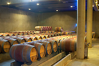 Oak barrel aging and fermentation cellar. Chateau Brane Cantenac, Margaux, Medoc, bordeaux, France