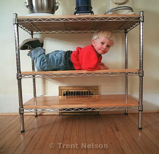 Nathaniel Nelson on the baker's rack shelf.<br />