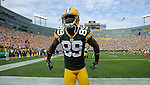 Green Bay Packers receiver James Jones looks for a spot in the stands to leap following his second half touchdown against the Buffalo Bills during the home opener at Lambeau Field in Green Bay, Wis., on Sunday, Sept. 19, 2010.