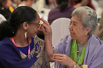 Chita Framo anoints the forehead of Jody Tyrell with oil on January 17, 2018, during an international gathering of United Methodist Women in Manila. <br /> <br /> Framo is a United Methodist deaconess who has served in several international leadership roles. Tyrell, an immigration attorney in New York, was part of a delegation of United Methodist Women who came to the Philippines from the United States.