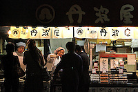 Clients buy food from an outside restaurant in Kyoto, Japan, on November 7, 2006. Kyoto is the former imperial capital of Japan, and today houses more than 1.5 million. Photo by Lucas Schifres/Pictobank