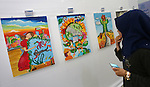 """Palestinians attend the art exhibition """"draw your dream for Gaza 2020"""", in Gaza city on Aug. 23, 2016. Photo by Mohammed Asad"""