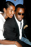 SEAN COMBS AND KIM PORTER 2003 <br /> MERCEDES-BENZ FASHION WEEK-<br /> MARC JACOBS 2004 SPRING COLLECTION.<br /> NEW YORK CITY.<br /> Photo By John Barrett/PHOTOlink/MediaPunch