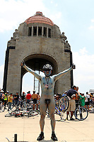 Mexico City, Mexico. 14th June 2014 - A man poses while people attend the 9th. Nudist Ciclotón 2014. With this protest demanding respect for vehicle users, to understand that the only thing protecting cyclists in the city is its clothing.. Photo by Miguel Pantaleon/VIEWpress