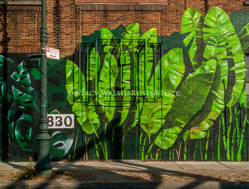 New York, NY, USA 24 August 2009 A tropical mural on the exterior of Artkraft Strauss Sign Company, in the Manhattan neighbourhood of Clinton. ©Stacy Walsh Rosenstock