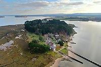 BNPS.co.uk (01202 558833)<br /> Pic: Albury&Hall/BNPS<br /> <br /> Love Islands ? - Then this idyllic spot in the middle of Poole harbour in Dorset could be the perfect escape.<br /> <br /> 15 acre Round island has been put up for long term rent by its owners for £15,000 a month.<br /> <br /> For that the lucky tenants will get the use of three cottages with space for up to 20 people as well the services of two caretakers who live in another property on the island. <br /> <br /> They provide boat 15 minute boat rides to the mainland at the request of the tenants.<br /> <br /> The nearest shops, restaurants and amenities are three miles away in Poole and the exclusive resort of Sandbanks.
