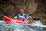 November 5, 2016 - Hendersonville, North Carolina, U.S. -  Kayaker, Geoff Calhoun, powers into the Scream Machine Rapids during the 21st annual Green Race.The Green River Narrows provides one of the most intense and extreme whitewater venues in the world and is home to many of the USA's most talented paddlers.  Green River Narrows, Hendersonville, North Carolina.