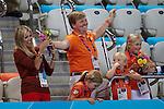 Engeland, London, 28 juli 2012.Olympische Spelen London.Kroonprins Willem-Alexander en prinses Maxima (M) moedigen met hun drie dochters Amalia (2eL), Alexia (R) en Ariane (2eR)