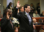 Nevada Assemblymen Tyrone Thompson, D-North Las Vegas, left, and David Gardner, R-Las Vegas, take the oath of office during opening day ceremonies at the Legislative Building in Carson City, Nev., on Monday, Feb. 2, 2015. (Cathleen Allison/Las Vegas Review-Journal)